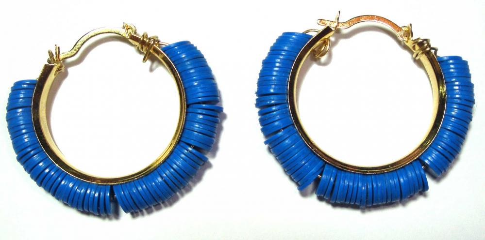 Tribal Chic earrings accentuated by Blue antique Vinyl Disc Beads